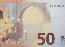 """Il verso della banconota con """"cambio colore"""" ed altre particolarità."""