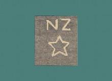 La filigrana dei francobolli: lettere NZ e stella a cinque punte.